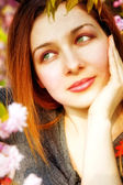 Day dreaming pensive woman and spring flowers — Stock Photo