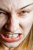 Stress concept - closeup on angry displeased woman — Stock Photo