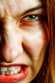 Face of angry woman with evil scary eyes — Stock Photo