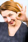 Beautiful woman showing ok sign — Stock Photo