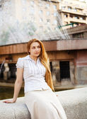 Pensive one woman resting in the city — Stock Photo