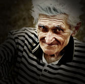 Artistic vintage portrait of senior old man — Stock Photo