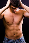 Sexy handsome muscular young man — Stock Photo