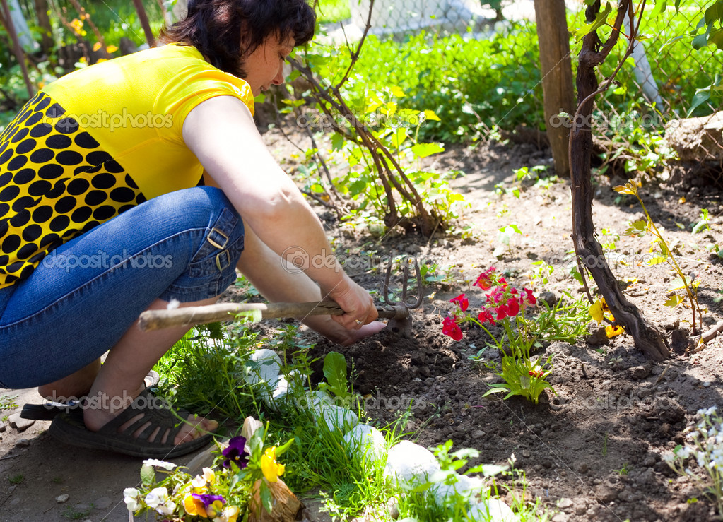 Gardening - one woman planting flowers — Stock Photo #9921269