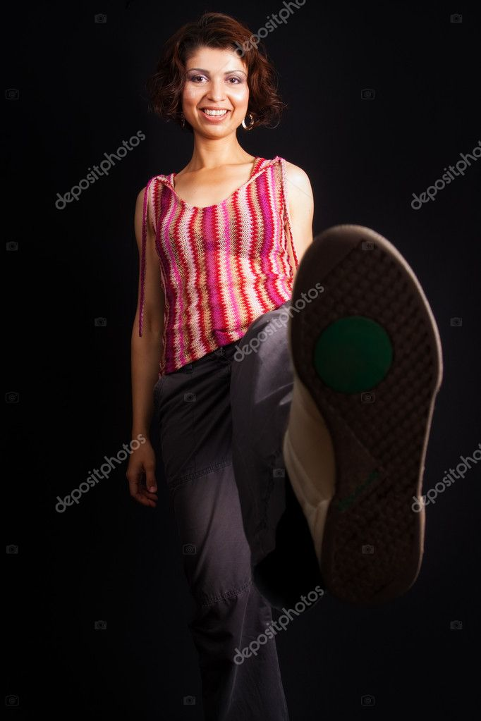Woman kicking and showing her sport shoe sole — Stock Photo #9921382
