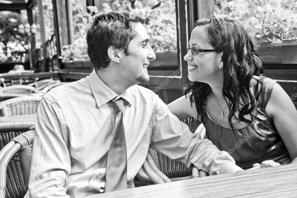 Happy carefree couple laughing at restaurant table  Stock Photo #9921519