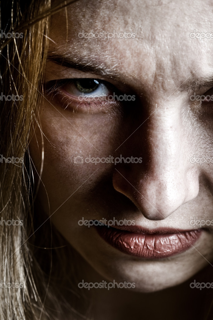 Close up on angry evil upset scary woman  Stock Photo #9921619