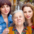 Family portrait - daughter granddaughter and grandmother — Stock Photo