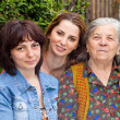 Family portrait - daughter granddaughter and grandmother — Stockfoto