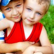 Hug of two cute brothers outdoor — Stock Photo