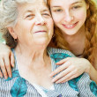 Happy family portrait - daughter and grandmother — Stockfoto