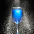 Glass with fresh icy water in motion — Stock Photo