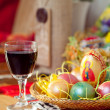 Royalty-Free Stock Photo: Easter painted eggs and wine glass on table