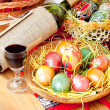 Royalty-Free Stock Photo: Easter painted eggs with wine bottle and glass