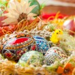 Easter colorful eggs in traditional basket — Stock Photo
