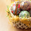 Easter painted eggs in traditional basket — Stock Photo