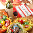 Easter colorful eggs with wine glass and bottle — Stock Photo