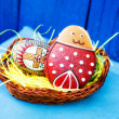 Easter festive egg and cookie in basket — Stock Photo