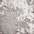 Stock Photo: Grungy textured background with peeling wall