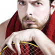 Royalty-Free Stock Photo: Portrait of tired male tennis player
