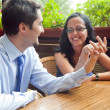Cheerful pretty couple at restaurant table — Stock Photo #9933317