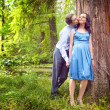 Couple having a candid romantic kiss outdoor — Stock Photo #9933362