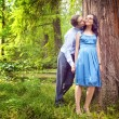 Stock Photo: Couple having a candid romantic kiss outdoor