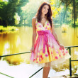 Sexy woman outdoor with colorful dress — Stock Photo #9933482