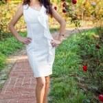 Sexy woman in elegant white dress outdoor — Stock Photo