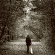 Lonely sad woman on the wood road — Stock Photo #9933600
