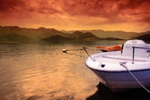 Boat on lake and colorful sunset sky — Stock Photo