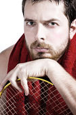 Portrait of tired male tennis player — Stock Photo