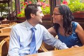 Happy couple at restaurant on honeymoon — Stock Photo