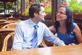 Cute joyful couple at restaurant table — Stock Photo