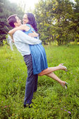 Embrace of happy couple outdoor — Stock Photo