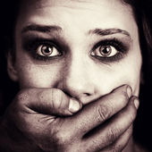 Scared woman victim of domestic torture and abuse — Stock Photo