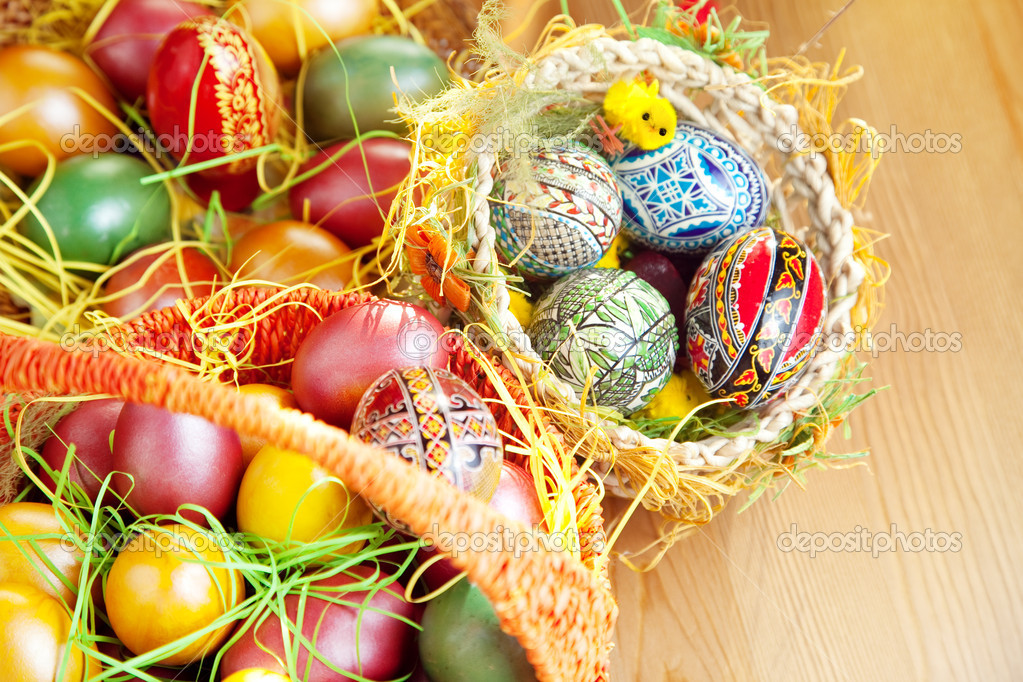 Easter painted eggs in traditional basket on table — Stock Photo #9932699
