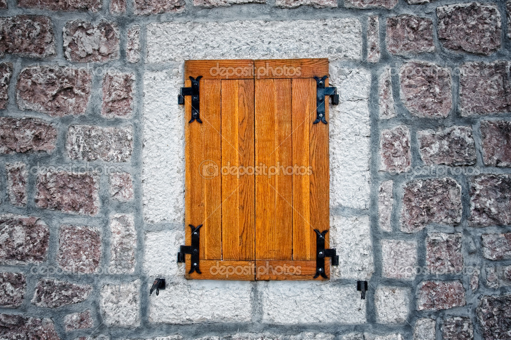 Wooden rustic antique window and textured stone wall  Stock Photo #9932935