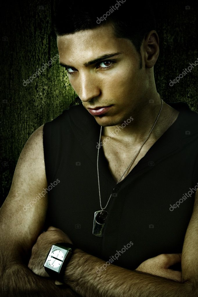 Grunge portrait of tough cool sexy young man — Stock Photo #9933117