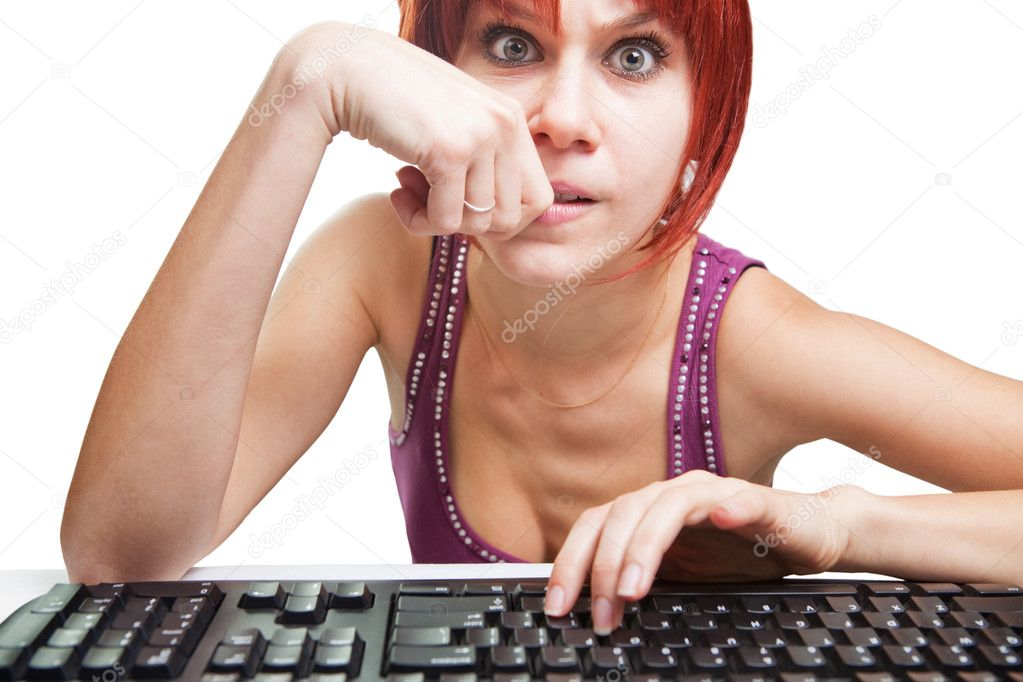 Angry woman on computer surfing the web  Stock Photo #9933555