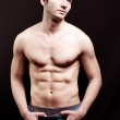 Shirtless young man with sexy abdomen — Stock Photo