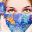 Woman with beautiful eyes and colorful scarf — Stock Photo