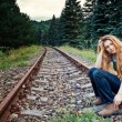 Sad suicidal lonely woman on railway track — Stock Photo