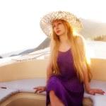 Beautiful blond woman on luxury boat — Stock Photo