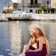 Stock Photo: Beautiful woman relaxing by the sea in Montenegro