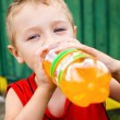 Child drinking unhealthy bottled soda — Stock Photo #9980746
