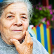 Portrait of one content old senior woman — Stock Photo
