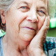 Happy content senior old woman — Stock Photo