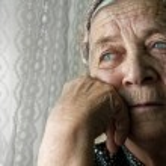 Sad lonely pensive old senior woman — Stock Photo