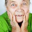 Excited senior woman with surprise expression — Stock Photo